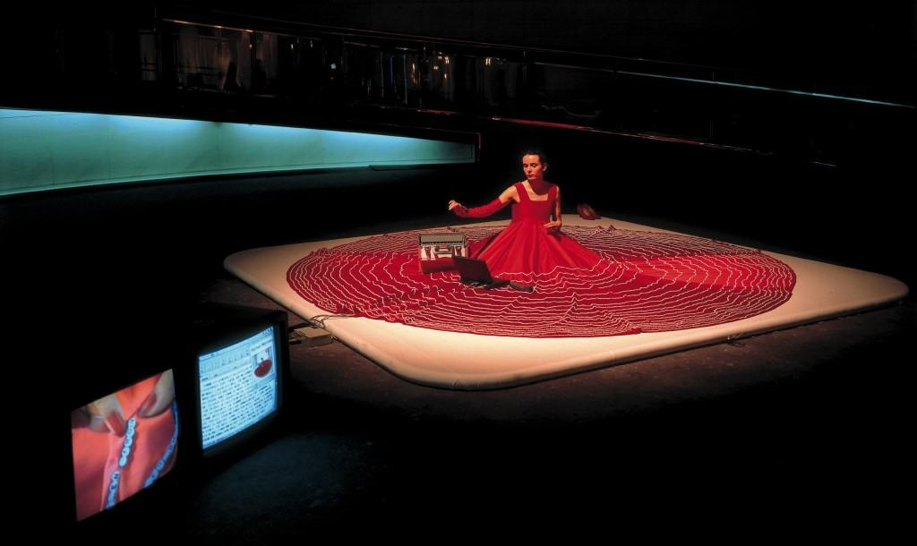 Hermes' Mistress  1996 Spiral Wacoal Art Center, Tokyo Hermes' Mistress bridges technology and traditional handwork. In the middle of a huge, expansive red dress, Frank sat with a portable computer, embroidering a spiraling path of letter beads that detailed information collected from the Internet.  (1994–2007: Travelled to: Exit Art,New York / Kunsthalle, Berlin / MOCA, Los Angeles / Bronx Museum, New York / Reina Sofia, Madrid / Frauenmuseum, Bonn / IAS, London / Kampnagel, Hamburg, UNESCO, Paris, Fondapol Paris, Chienku University Taiwan)